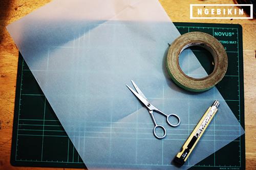 bahan 2 : kertas kalkir, gunting, dan cutter